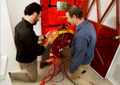 Testing home performance with blower door equipment