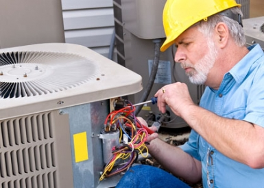 Person working on air conditioner