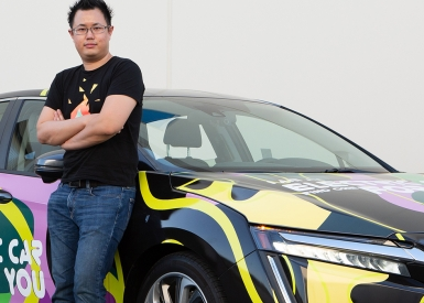 Kelvin Liu standing next to his newly wrapped plug-in hybrid Honda Clarity